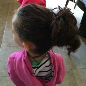 Do you know how hard it is to wrangle curly hair into a ponytail? I'm surprised she stood still while I did it!